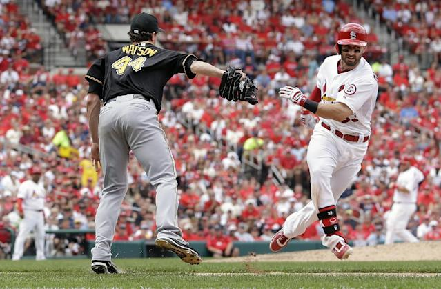 St. Louis Cardinals' Daniel Descalso, right, is tagged out along the first baseline by Pittsburgh Pirates relief pitcher Tony Watson (44) in the seventh inning of Game 2 of baseball's National League division series on Friday, Oct. 4, 2013, in St. Louis. (AP Photo/Jeff Roberson)
