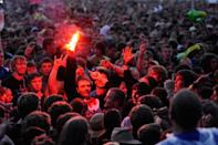 Enthusiastic partygoers at Rock am Ring soak up the exhilarating atmosphere on day three of the festival in 2011.