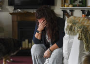 Natalie Walters, 53, becomes emotional while talking about her father at her home in Syracuse, N.Y., Tuesday, Sept. 21, 2021. Jack, who was staying at the Loretto Health and Rehabilitation nursing home in Syracuse, died of COVID-19 in December 2020. The facility's staffing has declined during the pandemic and Walters wonders if poor staffing played a role in her father's infection or death. Nationwide, one-third of U.S. nursing homes have fewer nurses and aides than before COVID-19 began ravaging their facilities, an Associated Press analysis of federal data finds. (AP Photo/Heather Ainsworth)