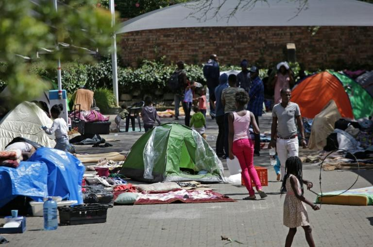 The asylum-seekers put up tents and spread their belongings around the carpark at the UN refugee agency (AFP Photo/Phill Magakoe)