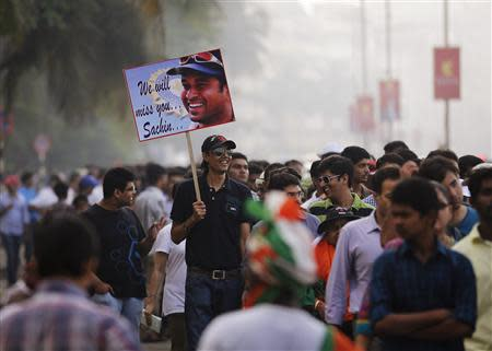 Cricket fans queue before a match outside a stadium in Mumbai November 14, 2013. Cricket-crazy India will have a lump in the throat as its favourite son, Sachin Tendulkar, walks out for one last time this week to play the game he has dominated for nearly a quarter of a century. The 'Little Master' will bring the curtain down on a glittering 24-year career at the age of 40 when he plays his 200th test match, against West Indies, at his home ground starting on Thursday. REUTERS/Danish Siddiqui \