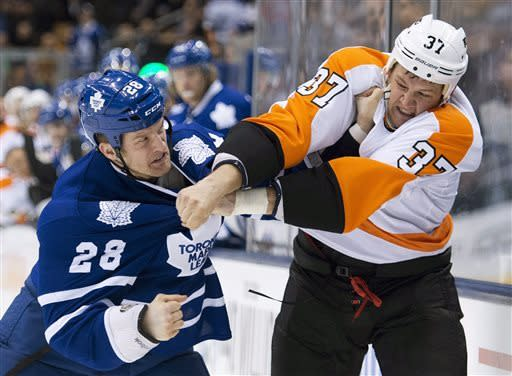 Toronto Maple Leafs forward Colton Orr, left, fights Philadelphia Flyers forward Jay Rosehill, right, during the first period of an NHL hockey game in Toronto on Thursday, April 4, 2013. (AP Photo/The Canadian Press, Nathan Denette)