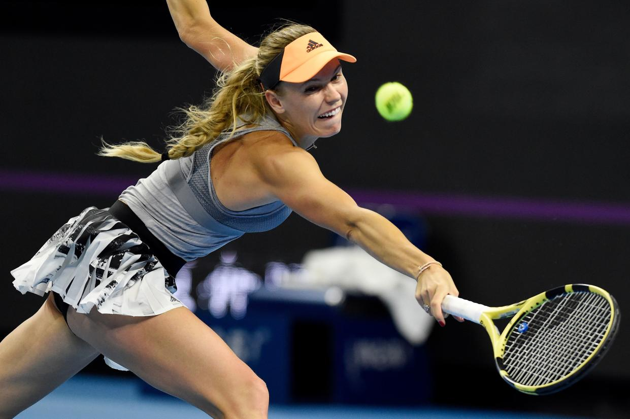 Caroline Wozniacki of Denmark hits a return during her women's singles semi-final match against Naomi Osaka of Japan at the China Open tennis tournament in Beijing on October 5, 2019. (Photo by Leo RAMIREZ / AFP) (Photo by LEO RAMIREZ/AFP via Getty Images)