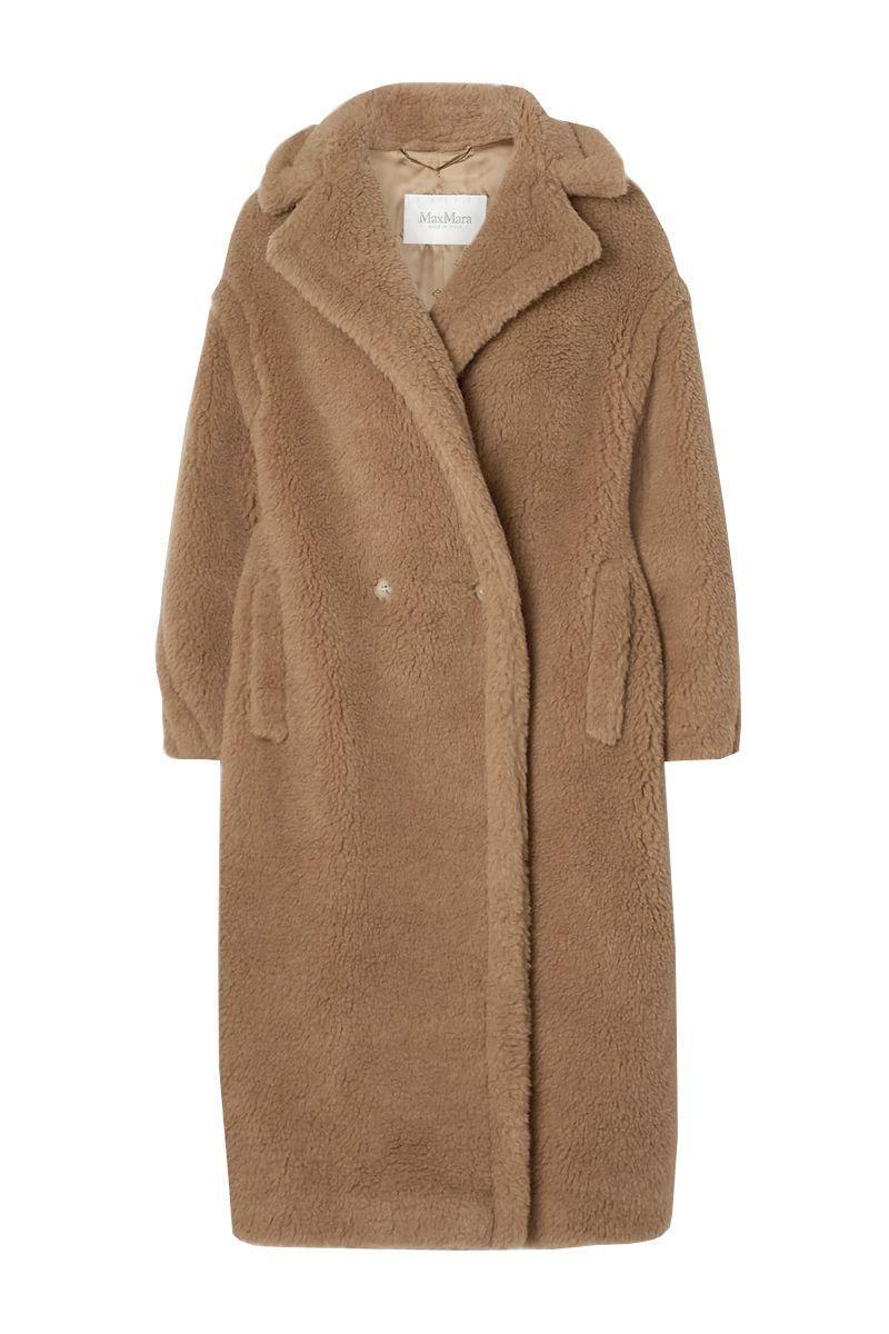 """<p><strong>Max Mara</strong></p><p>net-a-porter.com</p><p><strong>$3690.00</strong></p><p><a href=""""https://go.redirectingat.com?id=74968X1596630&url=https%3A%2F%2Fwww.net-a-porter.com%2Fen-us%2Fshop%2Fproduct%2Fmax-mara%2Fteddy-bear-icon-camel-hair-and-silk-blend-coat%2F1146974&sref=https%3A%2F%2Fwww.harpersbazaar.com%2Ffashion%2Ftrends%2Fg34113004%2Fbest-teddy-bear-coats%2F"""" rel=""""nofollow noopener"""" target=""""_blank"""" data-ylk=""""slk:Shop Now"""" class=""""link rapid-noclick-resp"""">Shop Now</a></p><p>The OG of the teddy bear coats has been worn by some of your favorite It girls and can be yours to rock as well.</p>"""