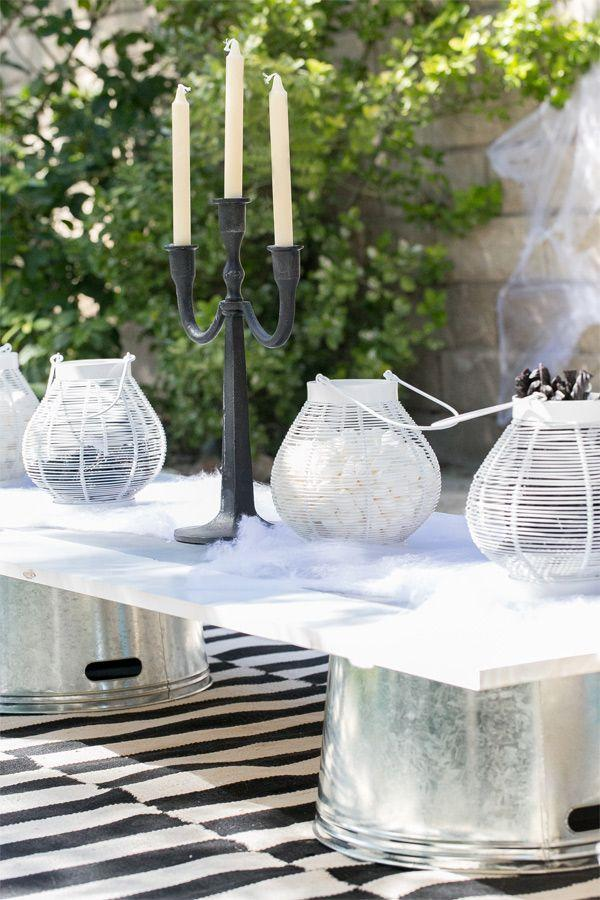 "<p>You may not have a giant candelabra on hand, but you probably have some summer lanterns (and you can always just use smaller candelabras). <a href=""https://www.housebeautiful.com/entertaining/holidays-celebrations/g21753908/halloween-lanterns/"" rel=""nofollow noopener"" target=""_blank"" data-ylk=""slk:Refresh them for Halloween"" class=""link rapid-noclick-resp"">Refresh them for Halloween</a> by filling them up with candy and placing them on top of faux spiderwebs. See more at <a href=""https://sugarandcharm.com/2013/10/kids-halloween-party-ideas.html?section-5"" rel=""nofollow noopener"" target=""_blank"" data-ylk=""slk:Sugar and Charm"" class=""link rapid-noclick-resp"">Sugar and Charm</a>.</p>"