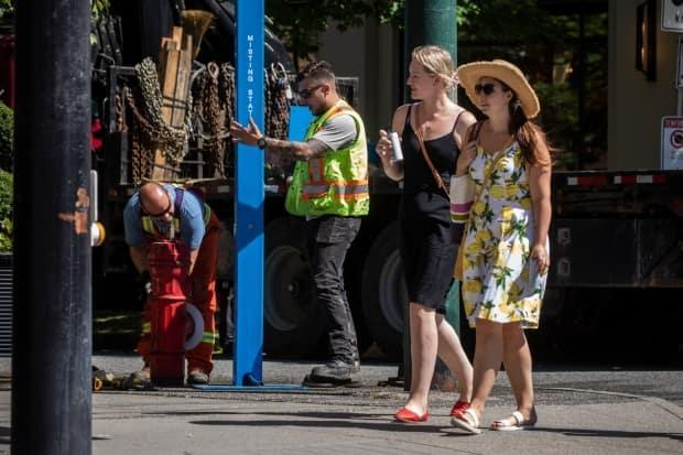 City of Vancouver workers install a misting station due to the heat wave in Vancouver, British Columbia on Friday, June 25, 2021.  (Ben Nelms/CBC - image credit)