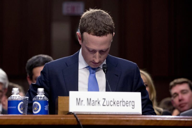 """FILE - In this April 10, 2018, file photo Facebook CEO Mark Zuckerberg looks down as a break is called during his testimony before a joint hearing of the Commerce and Judiciary Committees on Capitol Hill in Washington. Twitter's ban on political advertising is ratcheting up the pressure on Facebook and Zuckerberg to follow suit. Zuckerberg doubled down on Facebook's approach in a call with analysts Wednesday, Oct. 30, 2019, he reiterated Facebook's stance that """"political speech is important."""" (AP Photo/Andrew Harnik, File)"""