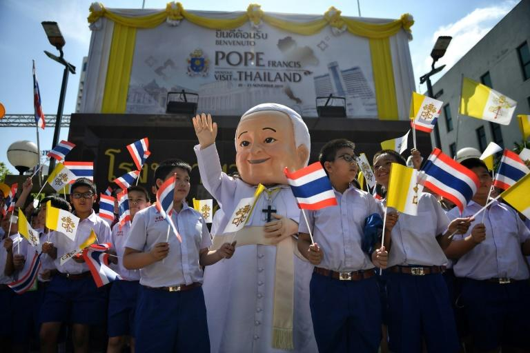 A costumed mascot and children yelling 'Sawadee Pa! (Hello Father)' greeted Pope Francis in Bangkok