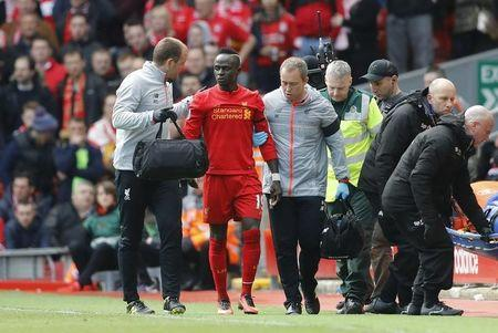 Liverpool's Sadio Mane leaves the pitch after sustaining a injury
