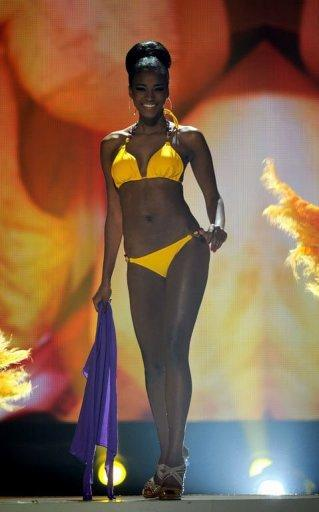 67c6352eda Miss Angola 2011 Leila Lopes poses on stage during the 60th annual Miss  Universe beauty pageant