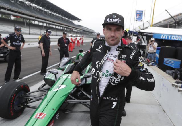 Jay Howard, of England, pulls off his racing suit after he qualified for the IndyCar Indianapolis 500 auto race at Indianapolis Motor Speedway in Indianapolis, Saturday, May 19, 2018. (AP Photo/Michael Conroy)