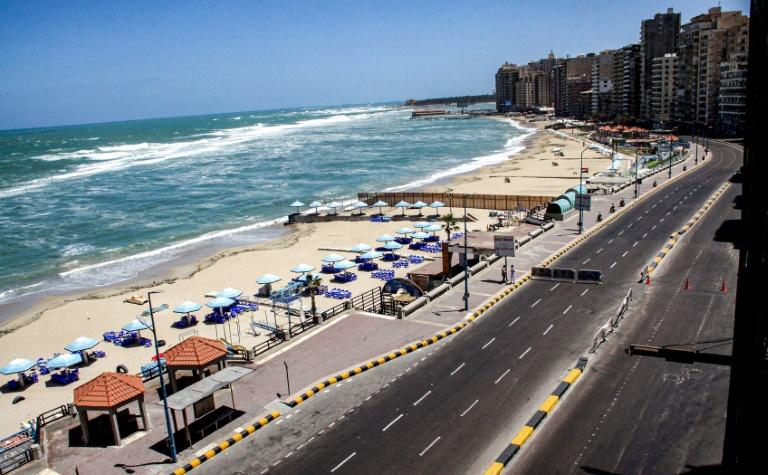 A deserted beach in Egypt's northern Mediterranean coastal city of Alexandria, empty due to the coronavirus pandemic, on the first day of Eid-al-Fitr on Sunday (AFP Photo/-)