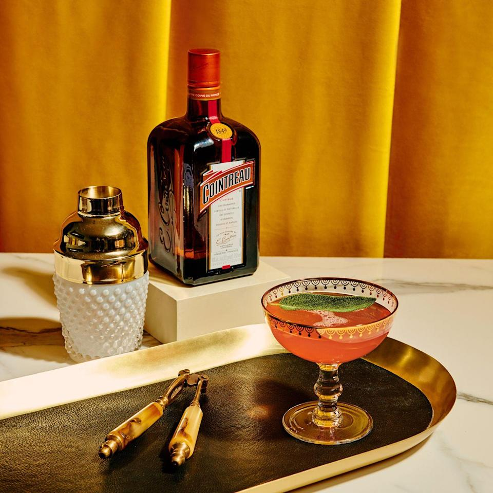 <p><strong>Ingredients</strong></p><p>.5 oz Cointreau <br>1 oz vodka <br>.5 oz fresh lemon juice <br>1 tablespoon cranberry sauce<br>Sparkling wine to finish </p><p><strong>Instructions </strong></p><p>Add all ingredients except sparkling wine into shaker. Add ice and shake. Fine strain into coupe glass. Finish with sparkling wine and garnish with sage leaf and orange wheel, if desired.</p>