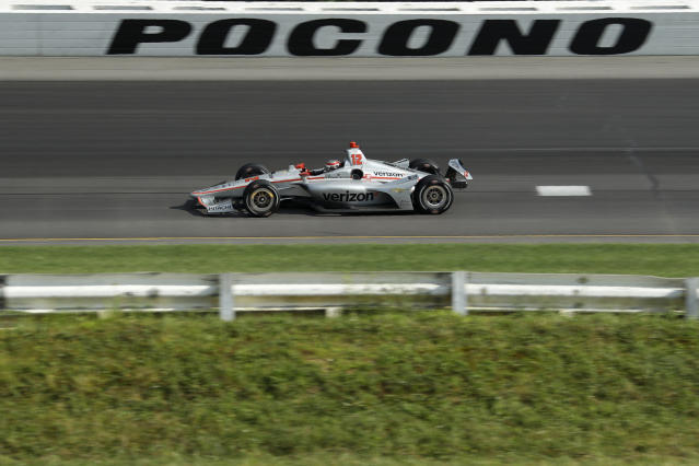 Will Power drives through Turn 1 during an IndyCar Series auto race at Pocono Raceway, Sunday, Aug. 18, 2019, in Long Pond, Pa. (AP Photo/Matt Slocum)