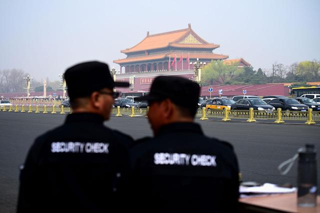 <p>Two security guards watch near the Tiananmen Square in Beijing on March 27, 2018. (Photo: Wang Zhao/AFP/Getty Images) </p>