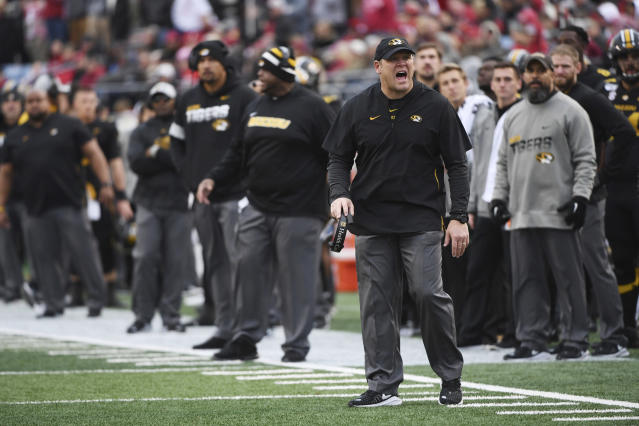 In this Friday, Nov. 29, 2019 photo Missouri coach Barry Odom watches his team during an NCAA college football game against Arkansas in Little Rock, Ark. Missouri fired Odom on Saturday, Nov. 30, 2019, ending the four-year stay of a respected former player who took over a program in disarray but could never get the Tigers over the hump in the brutal SEC. (AP Photo/Michael Woods)