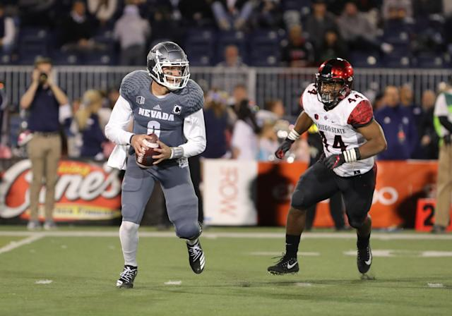 San Diego State LB Kyahva Tezino chases down Nevada QB Ty Gangi (6) during a game on Oct. 27, 2018. (Getty)