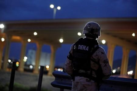 A member of the Mexican National Guard keeps watch near the border between Mexico and U.S.