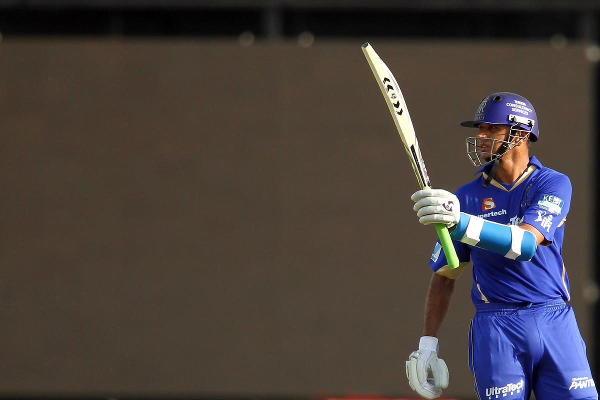 Rajasthan Royals captain Rahul Dravid raises his bat after reaching his fifty during match 4 of the Pepsi Indian Premier League between Delhi Daredevils and the Rajasthan Royals held at the Feroz Shah Kotla Stadium, Delhi on the 6th April 2013..Photo by Shaun Roy-IPL-SPORTZPICS ..Use of this image is subject to the terms and conditions as outlined by the BCCI. These terms can be found by following this link:..https://ec.yimg.com/ec?url=http%3a%2f%2fwww.sportzpics.co.za%2fimage%2fI0000SoRagM2cIEc&t=1506424659&sig=SCJ1U5hERjjpPzfK6k4xIg--~D