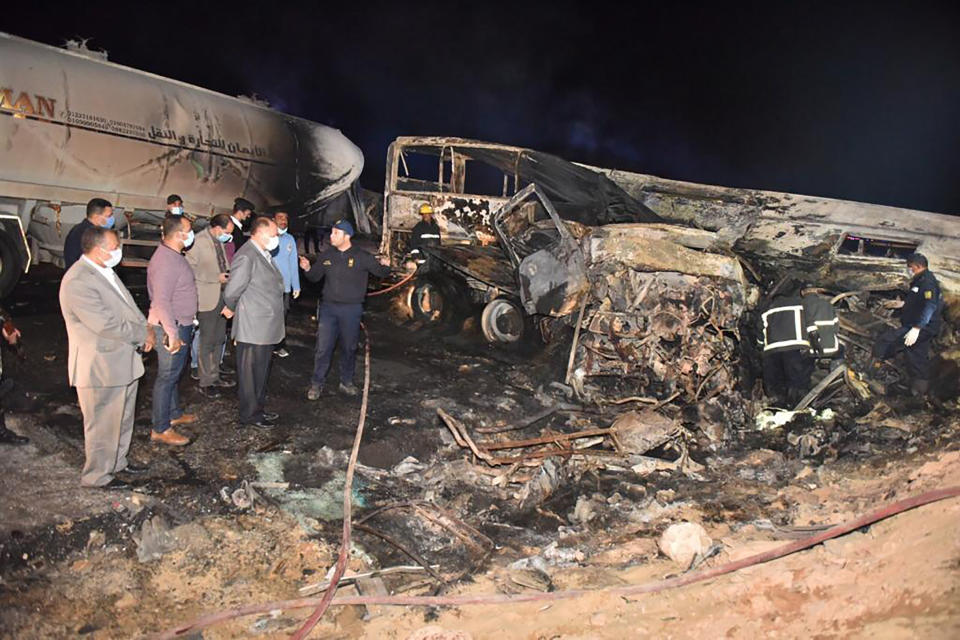 The authorities work on the collision site where a bus overturned Tuesday. Source: Assiut Governorate media office via AP