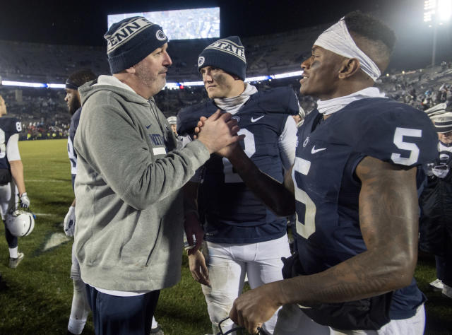 "Penn State offensive coordinator Joe Moorhead congratulates senior wide receiver <a class=""link rapid-noclick-resp"" href=""/ncaaf/players/230149/"" data-ylk=""slk:DaeSean Hamilton"">DaeSean Hamilton</a> after the win over Nebraska Saturday, Nov. 18, 2017 in State College, Pa. Penn State won over Nebraska 56-44. (Abby Drey/Cetre Daily Times/TNS)"