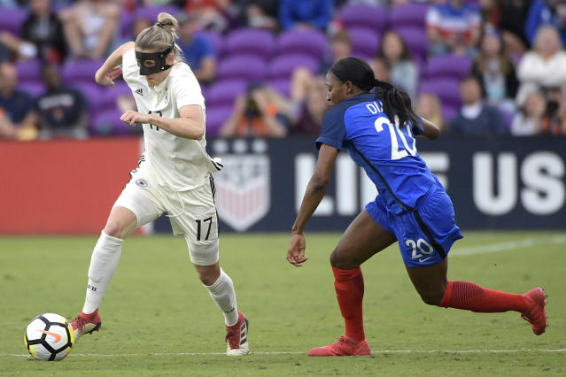 Germany's Verena Faisst (17) controls the ball in front of France's Kadidiatou Diani (20) during the second half of a SheBelieves Cup women's soccer match Wednesday, March 7, 2018, in Orlando, Fla. France won 3-0. (AP Photo/Phelan M. Ebenhack)