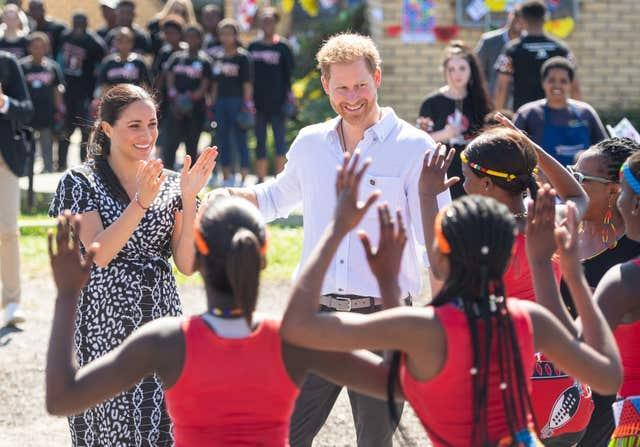 Meghan, pictured with Harry in the Nyanga Township in Cape Town, launched her legal action while in South Africa. Dominic Lipinski/PA Wire