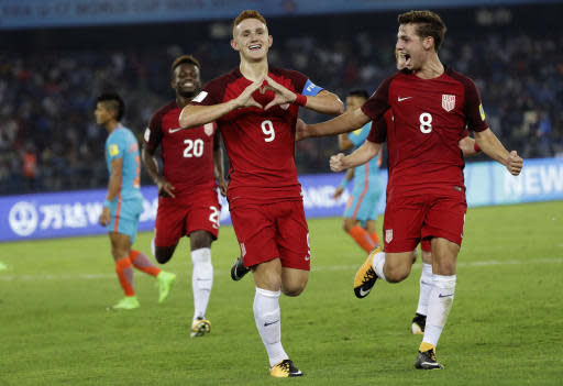 FILE - In this Oct. 6, 2017, file photo, U.S. soccer player Josh Sargent (9) celebrates a goal against India during their FIFA U-17 World Cup match in New Delhi, India. Midfielder Julian Green returns to the U.S. national team for the first time in two years, joining star midfielder Christian Pulisic on a young American roster for a May 28, 2018, exhibition against Bolivia at Chester, Pa. Sargent, who joined Germany's Werder Bremen this year but has yet to play for the club, is among seven players on the 22-man roster announced Sunday, May 20, 2018, who could make their national team debuts. (AP Photo/Tsering Topgyal, File)