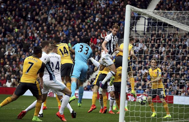 <p>West Bromwich Albion's Craig Dawson scores his side's first goal of the game </p>