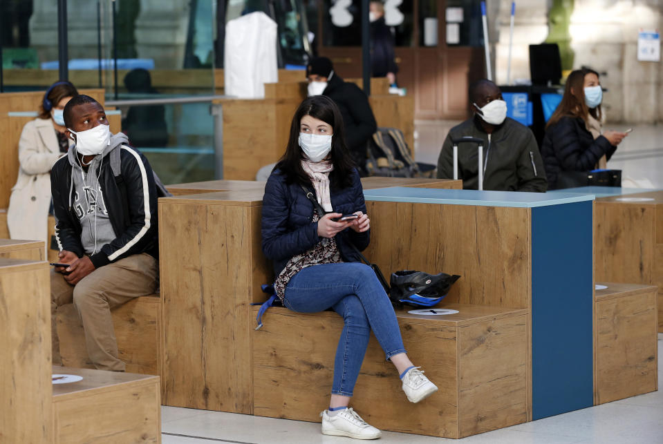 """A passenger wearing a protective face mask waits for the departure of his train at the """"Gare de Lyon"""" railway station as France is slowly reopening after almost two months of strict lockdown throughout the country due to the epidemic of coronavirus (COVID 19) on May 13, 2020 in Paris, France. France has begun a gradual easing of its lockdown measures and restrictions amid the coronavirus (COVID-19) outbreak. The Coronavirus (COVID-19) pandemic has spread to many countries across the world, claiming over 292,000 lives and infecting over 4.2 million people."""