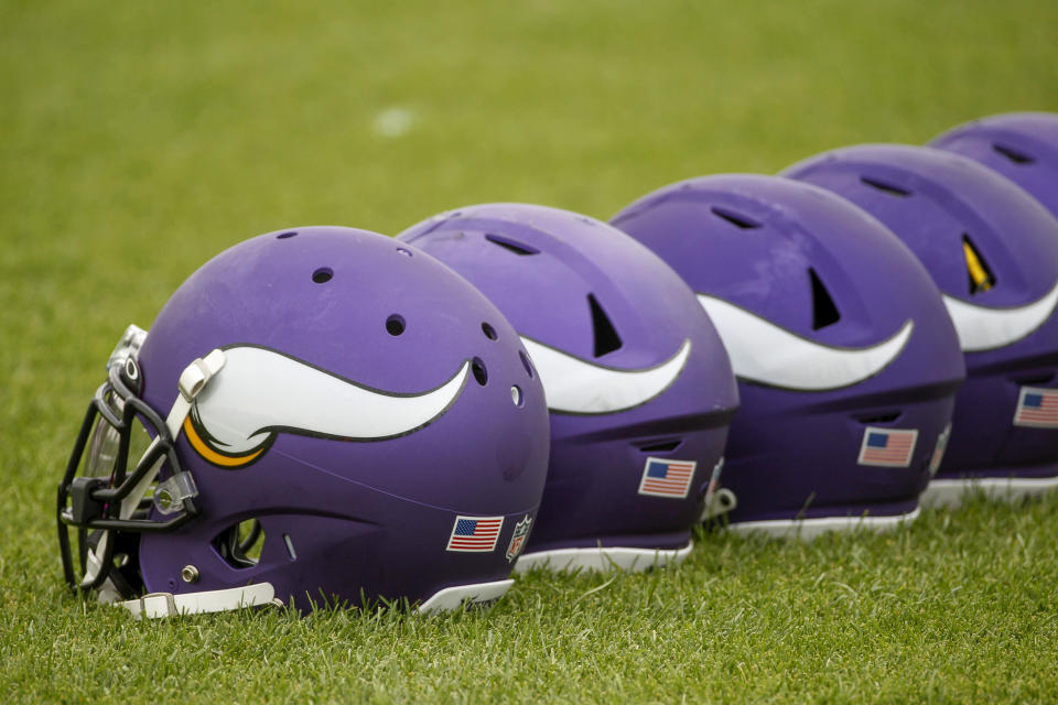 Minnesota Vikings players' helmets stand in line along the sidelines for the first day of the NFL football team's training camp Wednesday, July 28, 2021, in Eagan, Minn. (AP Photo/Bruce Kluckhohn)
