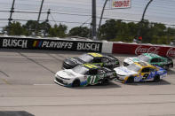 Justin Haley (11) moves with other cars during a NASCAR Xfinity Series auto race Saturday, Sept. 5, 2020, in Darlington, S.C. (AP Photo/Chris Carlson)