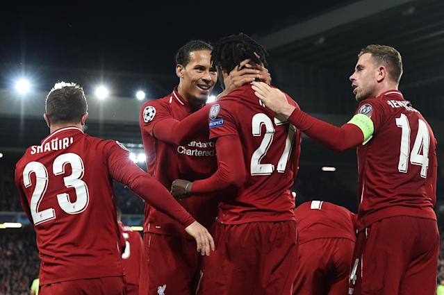 Liverpool's Belgium striker Divock Origi (2R) celebrates with Liverpool's Dutch defender Virgil van Dijk after scoring their fourth and winning goal during the UEFA Champions league semi-final second leg football match between Liverpool and Barcelona at Anfield in Liverpool, north west England on May 7, 2019. (Photo by Paul Ellis/AFP/Getty Images)