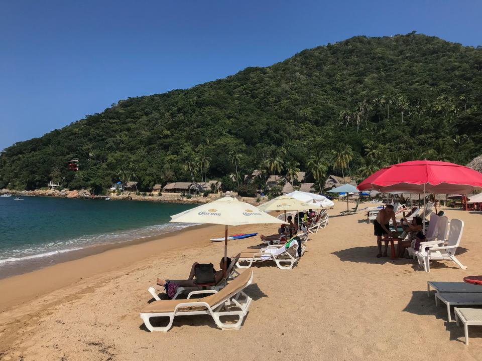 Tourists are seen at Yelapa village's beach nearby Puerto Vallarta in Jalisco state, Mexico on November 7, 2017.  / AFP PHOTO / DANIEL SLIM        (Photo credit should read DANIEL SLIM/AFP via Getty Images)