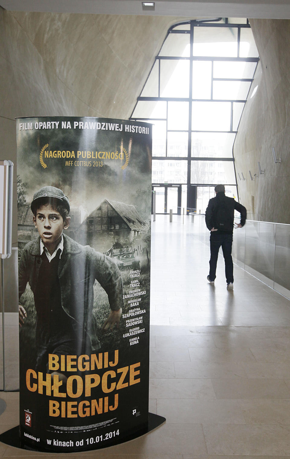 """Posters advertising the movie """"Run, Boy, Run"""" are displayed at the Museum of the History of Polish Jews prior to the world premiere of the movie by German Oscar-winning director Pepe Danquart about a Jewish boy struggling to survive the Holocaust, in Warsaw, Poland, Wednesday, Jan. 8, 2014. The movie is based on a true story of 10-year-old Yoram Friedman who escaped the Warsaw ghetto in 1943 and, hunted by the Nazis, hid in the woods near the city. (AP Photo/Czarek Sokolowski)"""