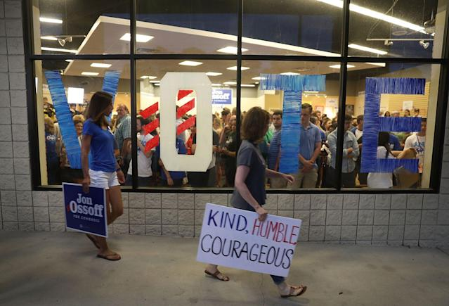 <p>People arrive to hear Democratic candidate Jon Ossoff speaks during a rally to thank volunteers and supporters on the last night before election day as he runs for Georgia's 6th Congressional District on June 19, 2017 in Roswell, Ga. (Photo: Joe Raedle/Getty Images) </p>