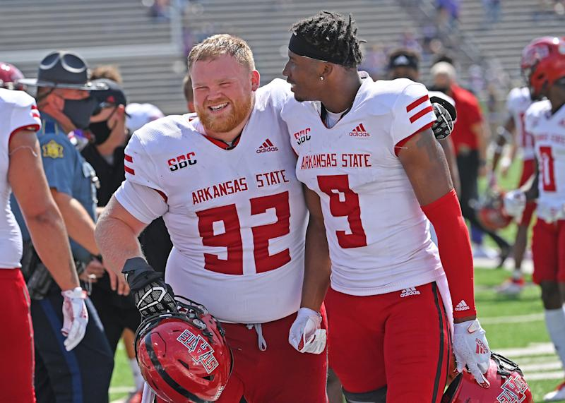 MANHATTAN, KS - SEPTEMBER 12: Defensive lineman Forrest Merrill #92 of the Arkansas State Red Wolves and wide receiver Jonathan Adams Jr. #9, react after beating the Kansas State Wildcats at Bill Snyder Family Football Stadium on September 12, 2020 in Manhattan, Kansas. (Photo by Peter Aiken/Getty Images)