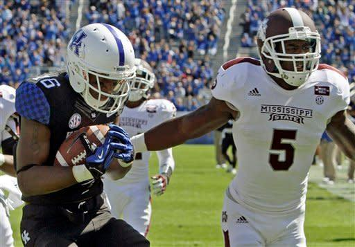 Kentucky wide receiver La'Rod King (16) gathers in a pass holding off Mississippi State defensive back Nickoe Whitley (5) to score a 32-yard touchdown during first half of an NCAA college football game in Lexington, Ky., Saturday, Oct. 6, 2012. (AP Photo/Garry Jones)