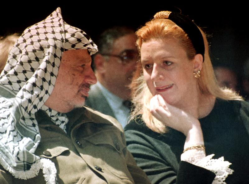 FILE - In this April 5, 1995 file photo, Suha Arafat and late Palestinian leader Yasser Arafat attend a conference in Gaza Strip. A former Israeli official on Wednesday, Aug. 29, 2012 denied suspicions that Israel poisoned Palestinian leader Yasser Arafat as France prepared to begin an investigation into his possible murder following a Swiss lab's claim that it found traces of a deadly substance on his belongings. (AP Photo/Nabil Judah, File)