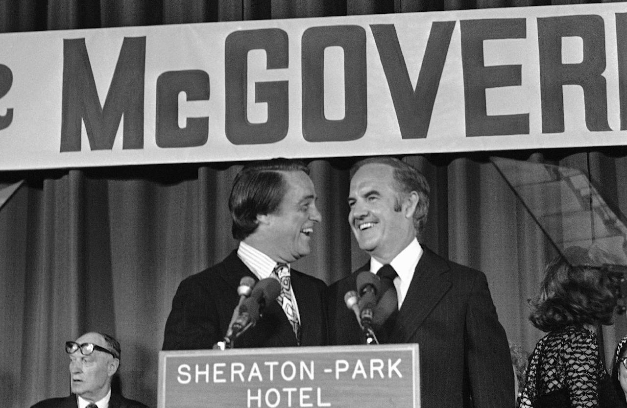 FILE - In this Aug. 8, 1972 file photo, Sen. George McGovern and Sargent Shriver in Washington after the Democratic National Committee endorsed Sargent Shriver as the new vice presidential nominee. A family spokesman says, McGovern, the Democrat who lost to President Richard Nixon in 1972 in a historic landslide, has died at the age of 90. According to the spokesman, McGovern died Sunday, Oct. 21, 2012 at a hospice in Sioux Falls, surrounded by family and friends. (AP Photo, File)