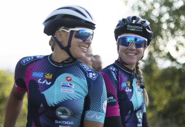 Tetiana Kalachova, left, and Christine Michelet, members of the female team of amateur cyclists completing the Tour de France route to raise awareness for women's cycling and promote the return of the women's Tour, in Carcassonne, France, Monday July 23, 2018. (AP Photo/Ciaran Fahey)