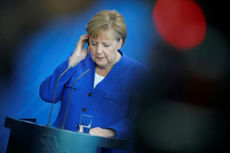 German Chancellor Angela Merkel announced her plan after marathon talks with other political leaders -- but green groups say the measures do not go far enough (AFP Photo/AXEL SCHMIDT)