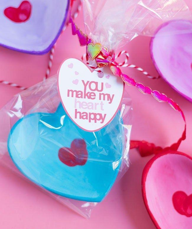 """<p>A pair of overlapping fingerprints form a heart right in the center of these sweet candy or jewelry dishes. They're just right to serve mini treats or to give as gifts — not just for Valentine's Day, but for Mother's Day, as bridesmaid gifts, or any time you want to show your love.<a href=""""https://designimprovised.com/2020/02/fingerprint-heart-craft-with-printable-gift-tags.html"""" rel=""""nofollow noopener"""" target=""""_blank"""" data-ylk=""""slk:"""" class=""""link rapid-noclick-resp""""><br></a></p><p><em><a href=""""https://designimprovised.com/2020/02/fingerprint-heart-craft-with-printable-gift-tags.html"""" rel=""""nofollow noopener"""" target=""""_blank"""" data-ylk=""""slk:Get the tutorial at Design Improvised »"""" class=""""link rapid-noclick-resp""""><em>Get the tutorial at Design Improvised »</em></a></em></p><p><strong>RELATED: </strong><a href=""""https://www.goodhousekeeping.com/holidays/valentines-day-ideas/g35140980/quarantine-valentines-day-ideas/"""" rel=""""nofollow noopener"""" target=""""_blank"""" data-ylk=""""slk:17 Valentine's Day Ideas to Help You Celebrate Your Love at Home"""" class=""""link rapid-noclick-resp"""">17 Valentine's Day Ideas to Help You Celebrate Your Love at Home</a><br></p>"""