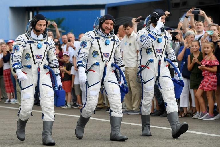 The current Russian space suits have V-shaped opening which allows for the traditonal pre-flight pee
