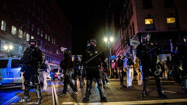 PHOTO: TOPSHOT - Oregon State Troopers block a street as they confront protesters in Portland, Oregon on November 4, 2020, during a demonstration called by the 'Black Lives Matter' movement, a day after the US Presidential Election.  (Kathryn Elsesser/AFP via Getty Images)