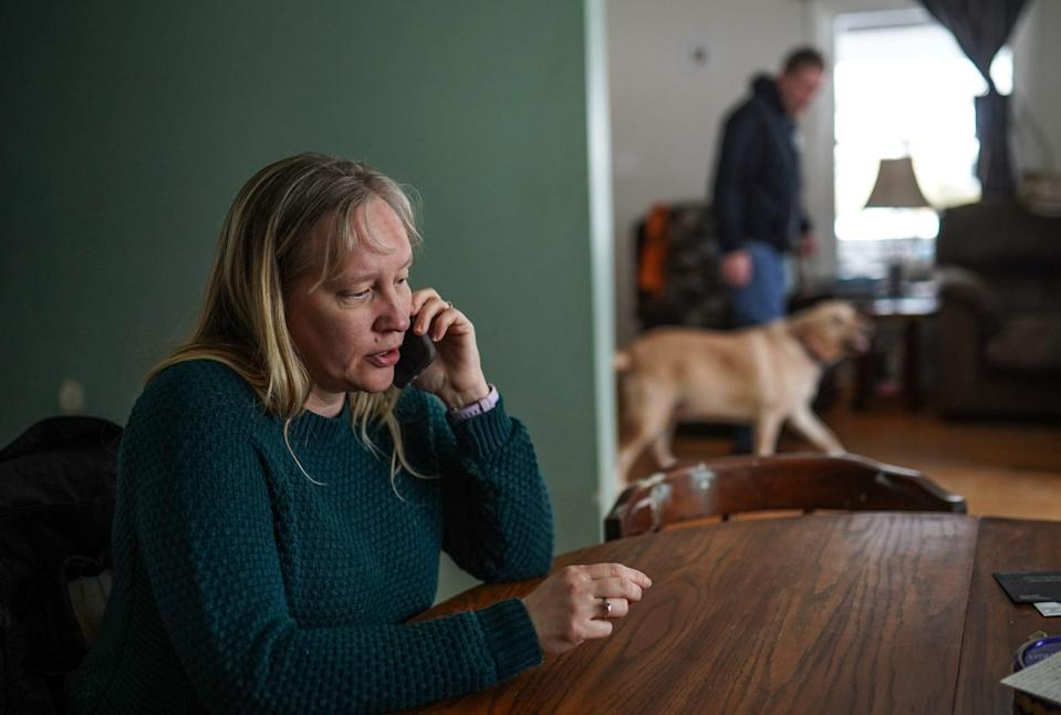 Kelly Schaeffer takes a call from her son serving a sentence in the Muskegon County Jail from her home in Muskegon on Wednesday, January 27, 2021 using Securus Technologies prison telecom company. Schaeffer was laid off until recently, and managing the cost of calls has been tight. Her son, who's 18, calls home every other day.