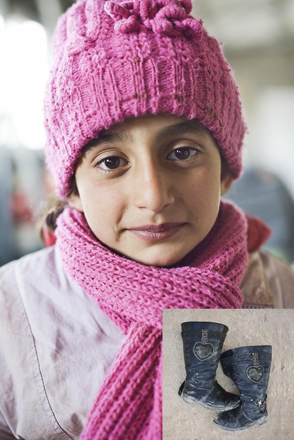 """<b>""""When we fled our village, bodies laid in the streets""""</b> <b>Rawa'a, nine, fled a massacre inher village. She escaped with her mother and a neighbour, Wael.</b> <b>Wael:</b> """"The Syrian army entered our village and started burning and destroying the houses of anyone who could have been working with the Free Syrian Army. They shot people in their homes and on the street. Dozens of people were killed. No-one was buried properly. We escaped to the nearby town and returned home to find bodies strewn on the streets. """"The soldiers put us all in a school hall and made us sing in support of President Bashar al-Assad. Guns were pointed at us and we knew we had to, even though he had destroyed our homes and our lives. We arrived in Jordan last night. It took us days to get here."""" <b>Ra'wa</b>: """"These are not my favourite shoes. The army stole [my favourite pair]. They took everything from my house. I used to play all day. The boys played outside and I played with them, too. We used to run and see who could jump up onto the high wall at the side of the street. In school, I liked all my subjects. """"The journey here was awful. I was scared. I had to stand up in the back of a truck and, as it went over the sand dunes, I felt like I was going to fall."""""""