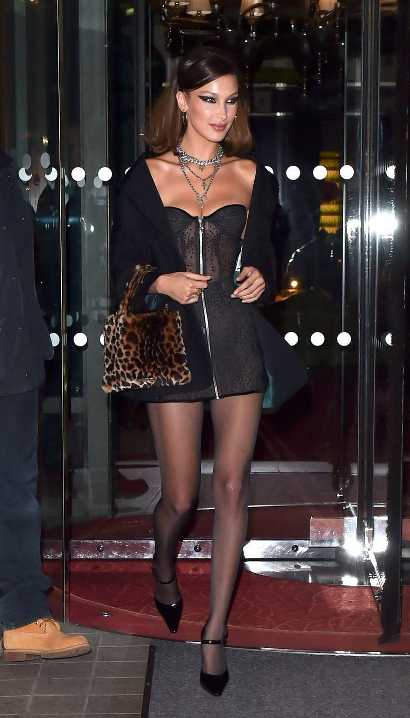 <p>In a sheer bustier strapless dress, cropped jacket, leopard print purse, tights, black pumps, and layered necklaces while out in Paris. </p>
