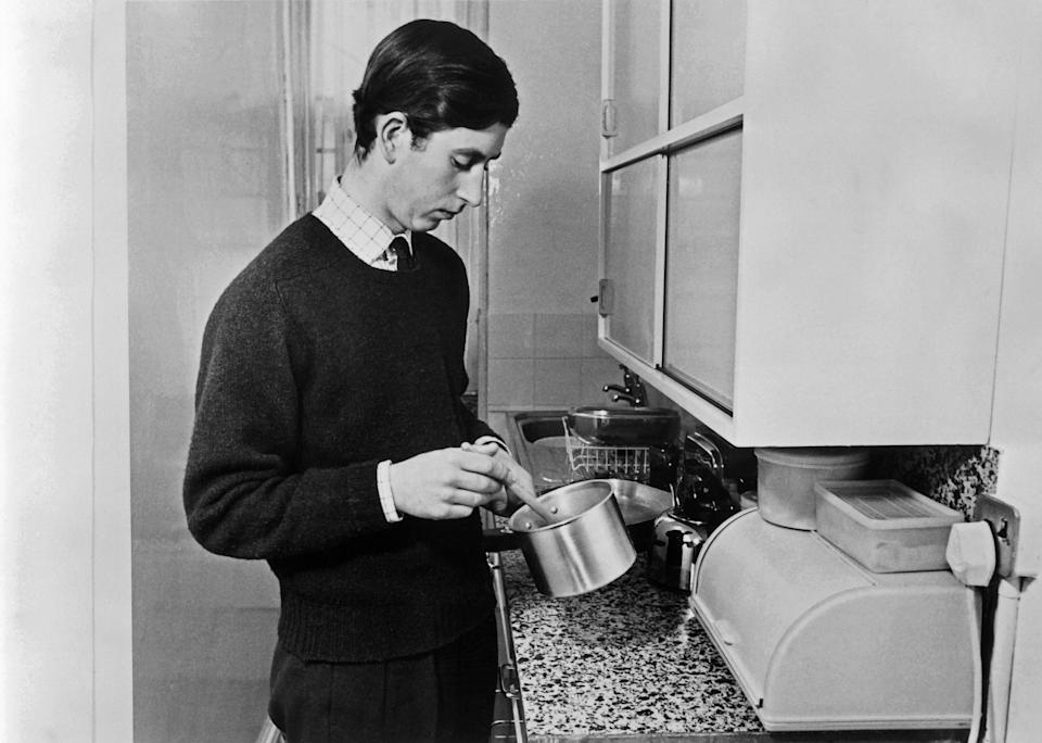 Charles, like other students, had to fend for himself at dinner time. Here cooking a meal on 8 February 1971. (AFP via Getty Images)