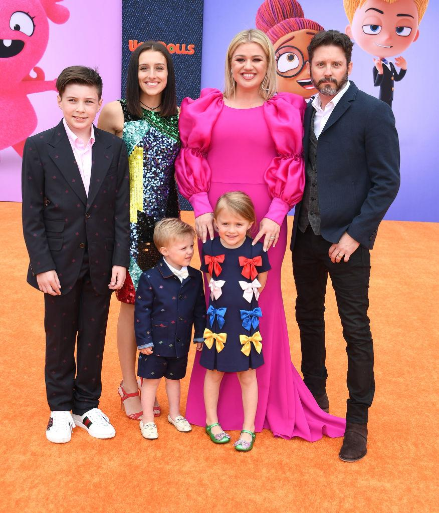 Kelly Clarkson poses with her kids and Brandon Blackstock at the L.A. premiere of